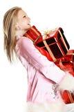 El retrato de la muchacha feliz con los regalos Imágenes de archivo libres de regalías