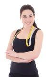 El retrato de la mujer deportiva atractiva joven con la cinta métrica es Fotografía de archivo