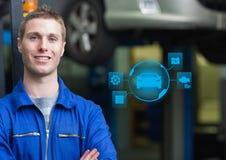 El retrato de un mecánico de automóvil confiado y el mecánico interconectan fotografía de archivo