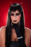 El retrato del diablo tiene gusto de la mujer Imágenes de archivo libres de regalías