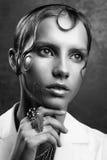 El retrato del estudio de la mujer atractiva con maquillaje perfecto y mojó Imágenes de archivo libres de regalías