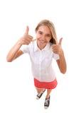 El retrato lleno del cuerpo del alto ángulo de la diversión del adolescente muestra el pulgar encima del gesto, aislado Fotografía de archivo libre de regalías