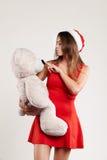 El retrato vertical del juguete de la muchacha de la Navidad refiere el fondo blanco Foto de archivo libre de regalías