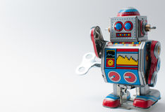 El robot colorido con mecánico enrolla para arriba llave Imágenes de archivo libres de regalías