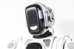 El robot grande está llevando las auriculares Fotografía de archivo libre de regalías