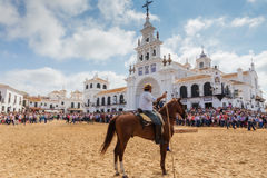 El ROCIO, ANDALUCIA, SPAIN - 26 JUNE 2016: Plaza near the church, rider waiting for the baptism of the herd. The crowd Stock Images
