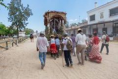 El ROCIO, ANDALUCIA, SPAIN - MAY 22: Peregrines accompany the statue of the saint. Royalty Free Stock Photo