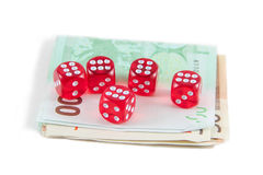 El rojo corta en cuadritos y dinero euro Fotografía de archivo libre de regalías