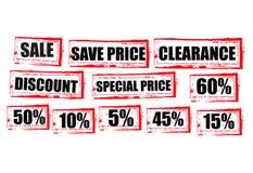 El rojo de la venta marca el gráfico del Grunge con etiqueta de las compras de la liquidación Foto de archivo