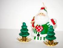 El rojo mira al trasluz la llama de Navidad Imagen de archivo libre de regalías