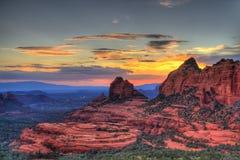 El rojo oscila puesta del sol Foto de archivo libre de regalías