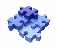 El rompecabezas junta las piezas del azul Foto de archivo libre de regalías