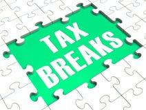 El rompecabezas muestra rebajas de impuestos Fotografía de archivo libre de regalías