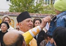 El sacerdote y el cabrito Fotos de archivo libres de regalías