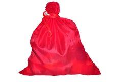 El saco rojo sujetado para los regalos Fotos de archivo libres de regalías