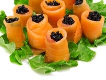 El salmón rueda con el caviar Fotografía de archivo libre de regalías