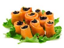 El salmón rueda con el caviar Foto de archivo libre de regalías