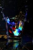 El salpicar colorido del agua Imagenes de archivo