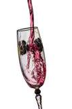 El salpicar del vino rojo Fotos de archivo