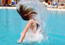 El saltar de la piscina Imagen de archivo libre de regalías