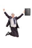 El saltar encantado del hombre de negocios de la alegría Imágenes de archivo libres de regalías