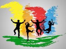 El salto colorido indica felicidad y el positivo de los amigos Fotografía de archivo libre de regalías