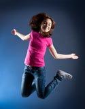 El salto de la chica joven Fotografía de archivo