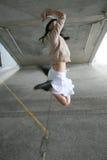 El salto de la muchacha Fotos de archivo libres de regalías