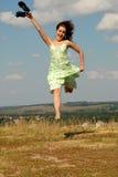 El salto de la muchacha Imagenes de archivo