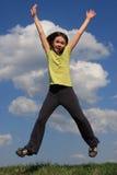 El salto de la muchacha al aire libre Fotografía de archivo