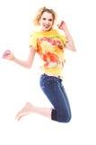 El salto de la muchacha de la alegría Fotografía de archivo libre de regalías
