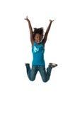 El salto de la muchacha feliz imágenes de archivo libres de regalías