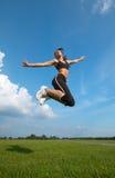 El salto de la mujer Imagen de archivo libre de regalías