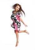 El salto de la niña de la alegría foto de archivo libre de regalías