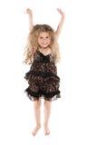 El salto de la niña feliz Imagenes de archivo