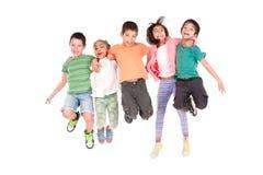 El salto de los niños Fotos de archivo
