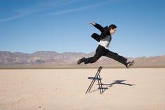 El salto del hombre de negocios Imagenes de archivo