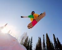 El salto del Snowboarder Imagen de archivo libre de regalías