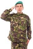 El saludar joven del soldado del ejército Foto de archivo