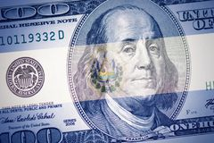 El salvador flag on a american dollar money background. Colorful el salvador flag on a american dollar money background stock photos