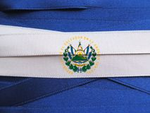El Salvador flag or banner. Made with blue and white ribbons royalty free stock photography