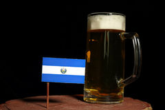 El Salvador flag with beer mug isolated on black. Background stock image