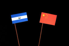 El Salvador flag with Chinese flag isolated on black. Background stock photography