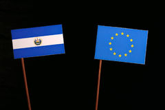 El Salvador flag with European Union EU flag isolated on black. Background royalty free stock images