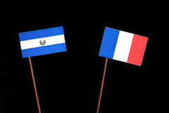El Salvador flag with French flag isolated on black. Background royalty free stock photo