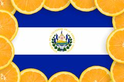 El Salvador flag in fresh citrus fruit slices frame. El Salvador flag in frame of orange citrus fruit slices. Concept of growing as well as import and export of vector illustration