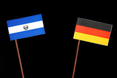 El Salvador flag with German flag isolated on black. Background royalty free stock photo