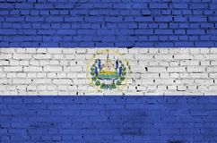El Salvador flag is painted onto an old brick wall stock images