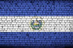 El Salvador flag is painted onto an old brick wall stock illustration