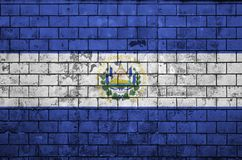 El Salvador flag is painted onto an old brick wall stock image